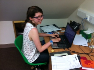 Kirsty, our hardworking volunteer, working away in the new collections staff office.