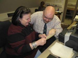 Evelyn works with archivist Richard McKenzie.