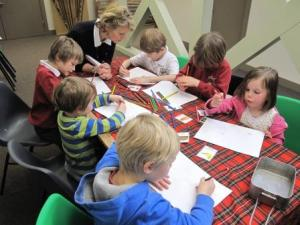 Emily helps a class of nursery children from Murthly Primary School design their own rations for a First World War soldier.