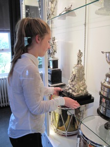 Olivia spent her last day polishing silver for display.