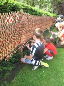 Crosses being laid up at our Memorial Wall on 30th July 2016 in remembrance of the 181 men who were killed at High Wood 100 years before.
